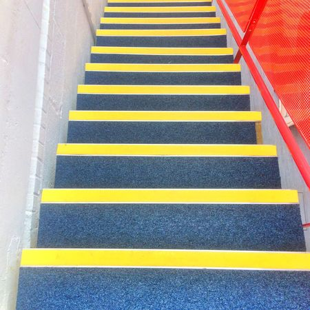 Stairway with yellow safety stripes Yellow Steps Steps And Staircases High Angle View The Way Forward Staircase Indoors  No People Day Close-up Health And Safety Saftey Warning