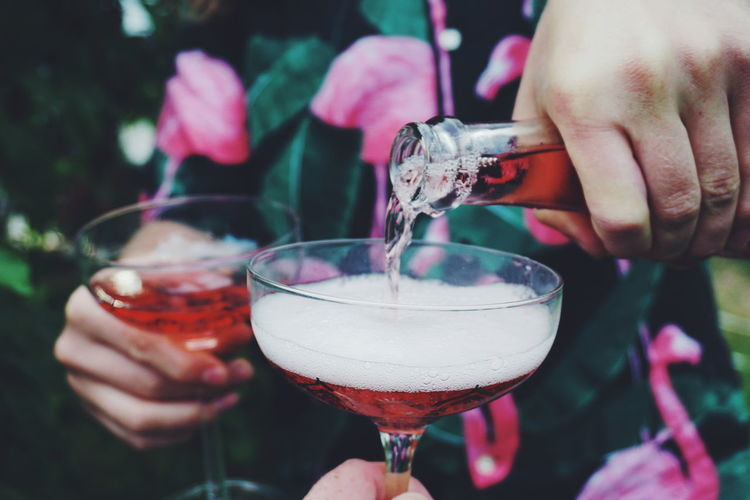 Serving rosé wine at a garden party