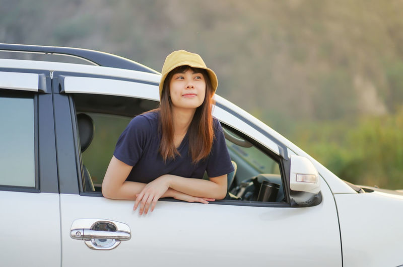 Portrait of a young woman in car