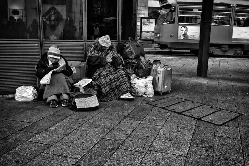 Beggar Beggars Begging Black & White Black And White Building Exterior City Day EyeEm Gallery Full Length Outdoors People Pleading Poverty Social Issues Street Street Photography Warm Clothing