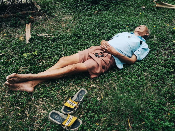 High angle view of man lying on field