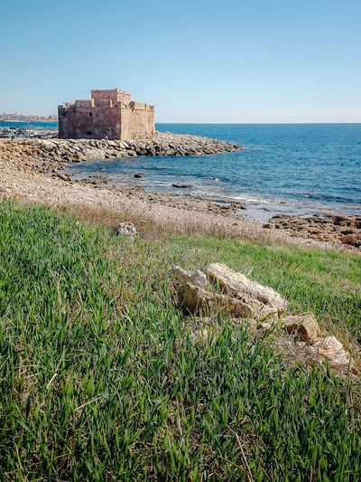 Ancient Ancient Civilization Architecture Beauty In Nature Building Exterior Built Structure Castle Clear Sky Copy Space Day Grass History Horizon Over Water Nature No People Old Ruin Outdoors Scenics Sea Sky Tranquility Water