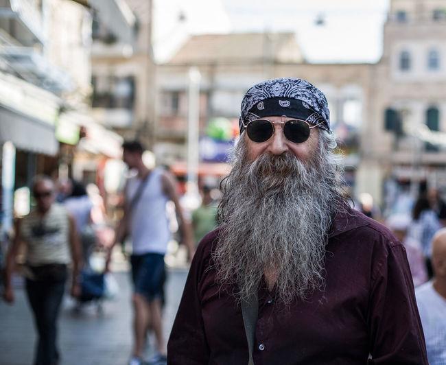 Portrait of man wearing sunglasses on street in city