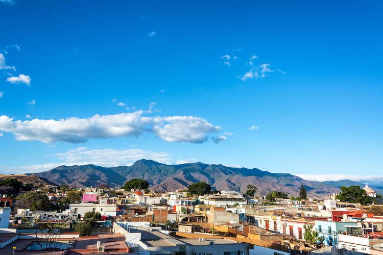 Town Against Blue Sky