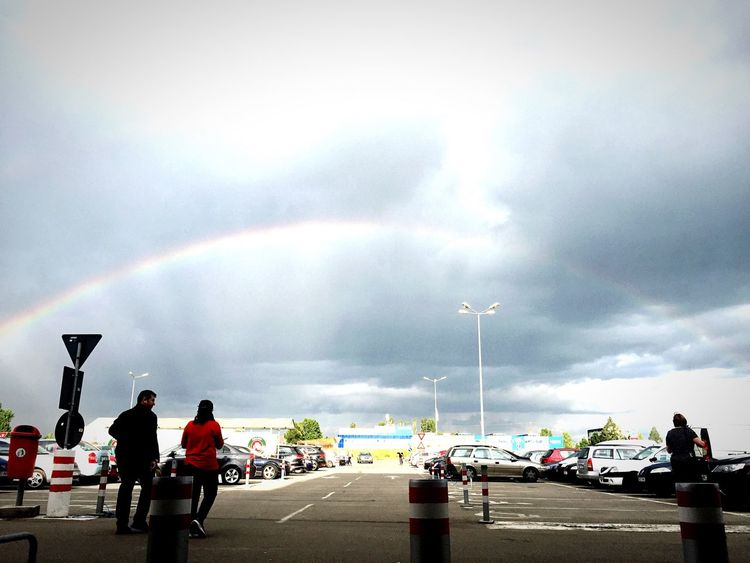 The Photojournalist - 2016 EyeEm Awards Rainbow Sky And Clouds Parking Lot People Walking  Under The Rainbow
