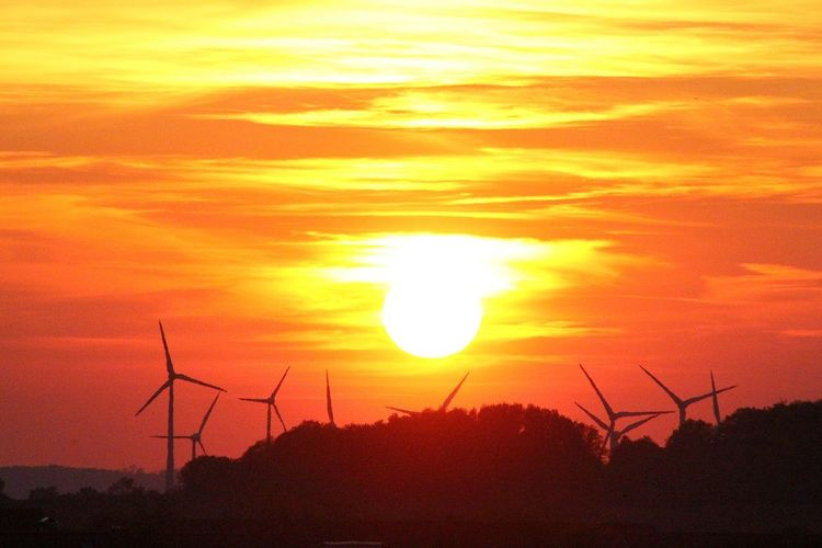 Orange Color Wind Power Technology Electricity Pylon Wind Turbine Sunset Alternative Energy Fuel And Power Generation Rural Scene Electricity  Silhouette