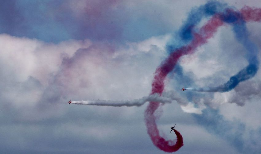 Red arrows- air display. Airshow Smoke - Physical Structure Vapor Trail Teamwork Sky Performance Speed Flying Cloud - Sky Air Vehicle Fighter Plane Military Airplane Formation Flying Mid-air Red Airplane Motion