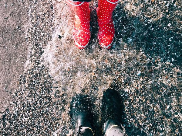 Fashion Wave Water Low Section Human Leg Shoe Human Foot Human Body Part Limb Standing Lifestyles Personal Perspective Real People Directly Above Red Human Feet High Angle View Day Leisure Activity Outdoors