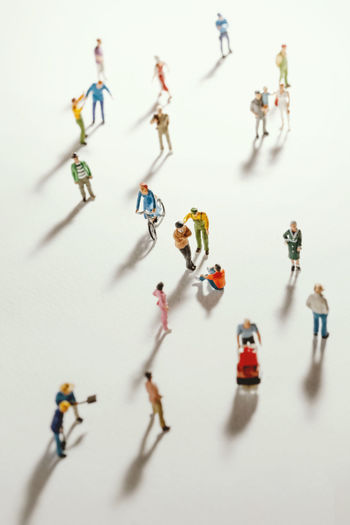 High angle view of figurines on white background