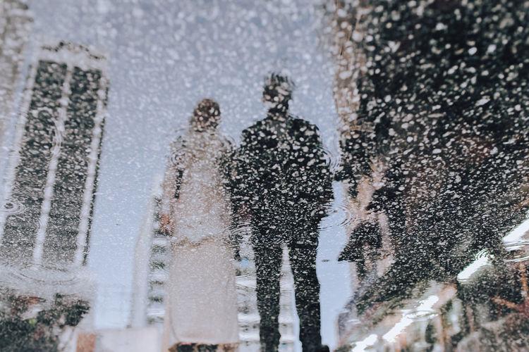 Panoramic view of people splashing water in winter