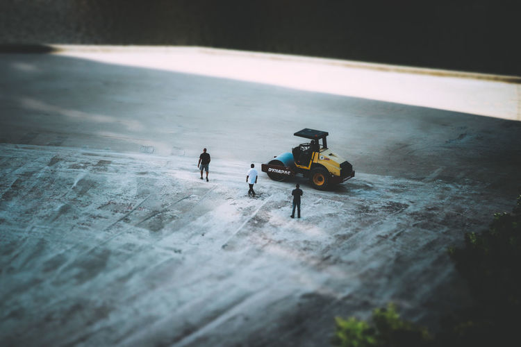 High angle view of people playing with toy car