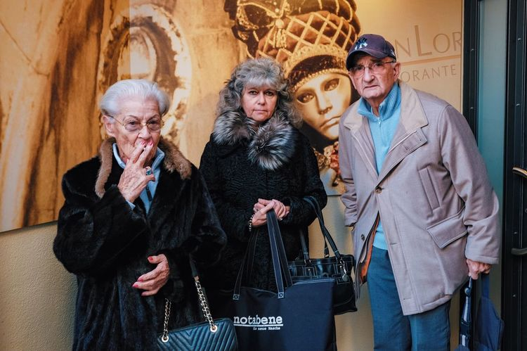 We are family. Senior Adult Wealth Arts Culture And Entertainment Warm Clothing Standing Luxury Fur Coat Women People City Adult Real People Friendship Adults Only Outdoors One Person Day