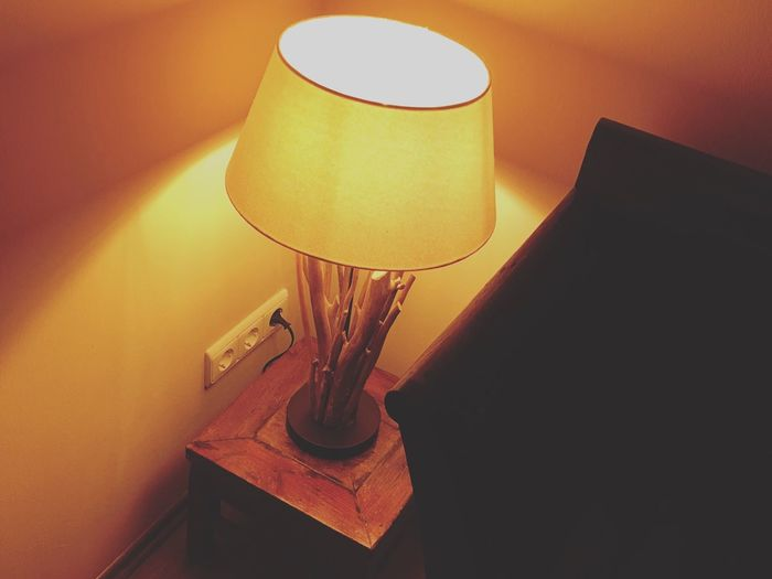Lighting Equipment Electric Lamp Indoors  Illuminated No People Wall - Building Feature Home Interior Electricity  Close-up Still Life Table Electric Light Light Technology Orange Color Lamp Shade  High Angle View
