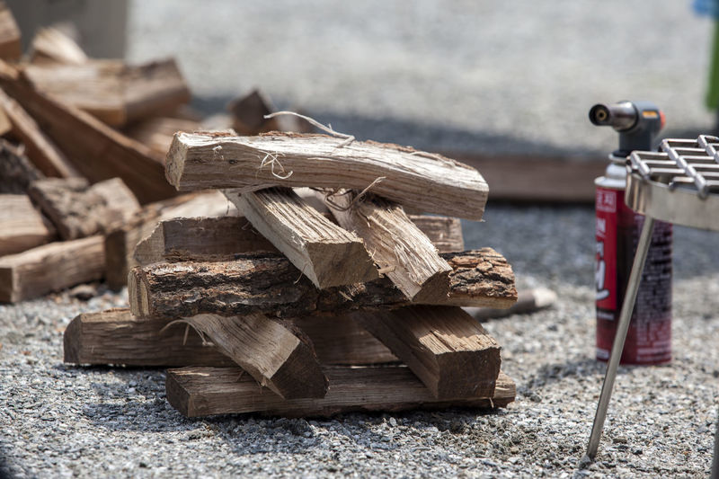Stack Of Firewood On Field
