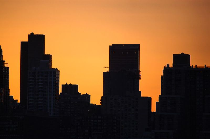 Buildings Against Clear Sky During Sunset