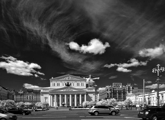 Cars on street against bolshoi ballet theater