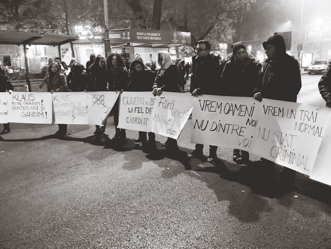 What We Revolt Against Political Protester Peoplephotography The Week On Eyem Untold Story Romania Streetphotography Blackandwhite Photography On The Way Resist The Photojournalist - 2017 EyeEm Awards Black And White Friday