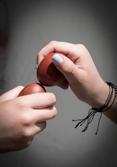 Two people crashing the red easter eggs. easter tradition in cyprus