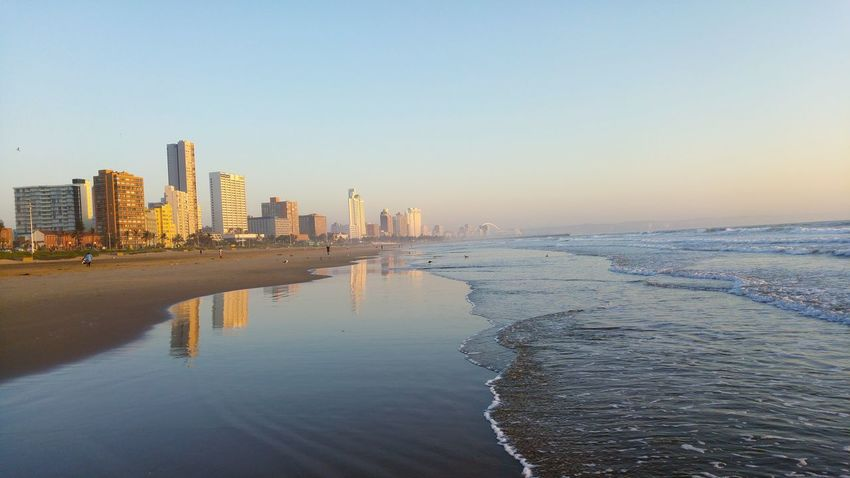 Sunrise in Durban South Africa City View  Durban Beachfront Beach Walk Durban South Africa Enjoying The Sun Sea Side Beach Walk New Day Rising Sunrise Colors Cityscapes City Skyline Cityworldwide Beachwalk Lost In The Landscape