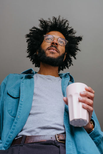 Portrait of man holding coffee cup