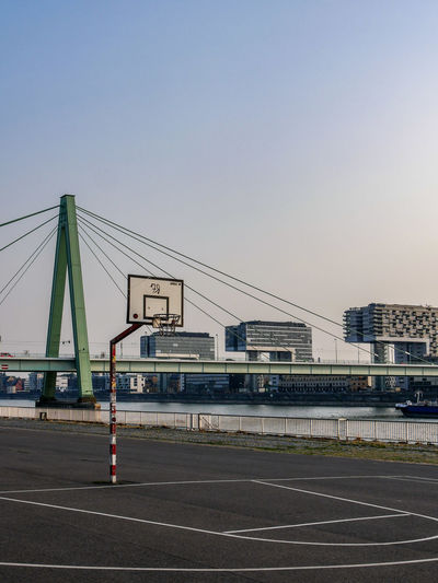 URBANANA #urbanana: The Urban Playground Basketball Architecture Available Light Bridge Bridge - Man Made Structure Building Building Exterior Built Structure City Clear Sky Connection Copy Space Day Mode Of Transportation Nature No People Outdoors Road Sky Sport Street Streetphotography Transportation urban sports
