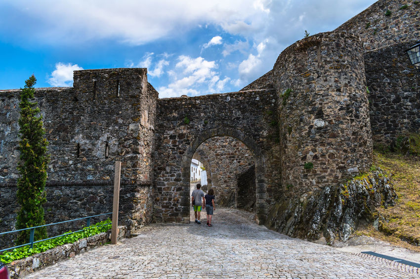 Castelo de Marvão Adult Ancient Ancient Civilization Arch Archaeology Architecture Built Structure Cloud - Sky Day Direction Full Length History Nature Old Old Ruin One Person Outdoors Ruined Sky Stone Wall The Past The Way Forward Travel Travel Destinations Women