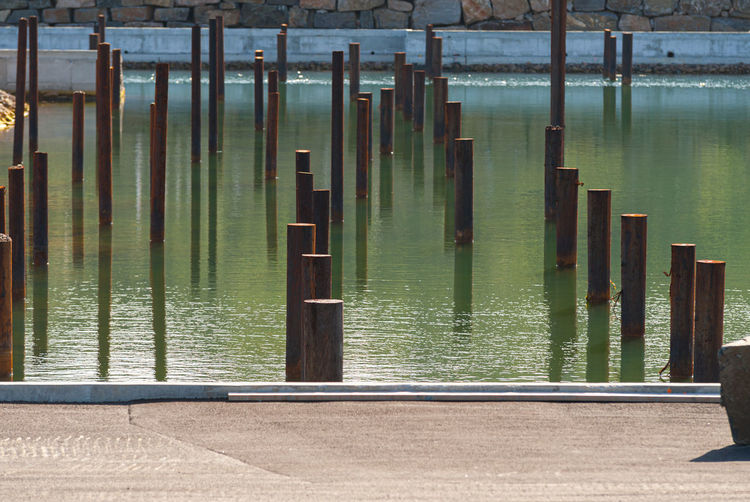 Wooden post on pier over lake