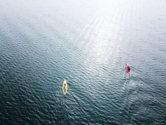 High Angle View Of People Kayaking On Lake
