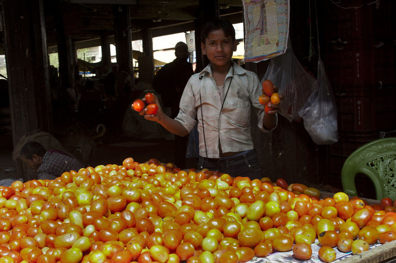 Full length of man standing at market stall
