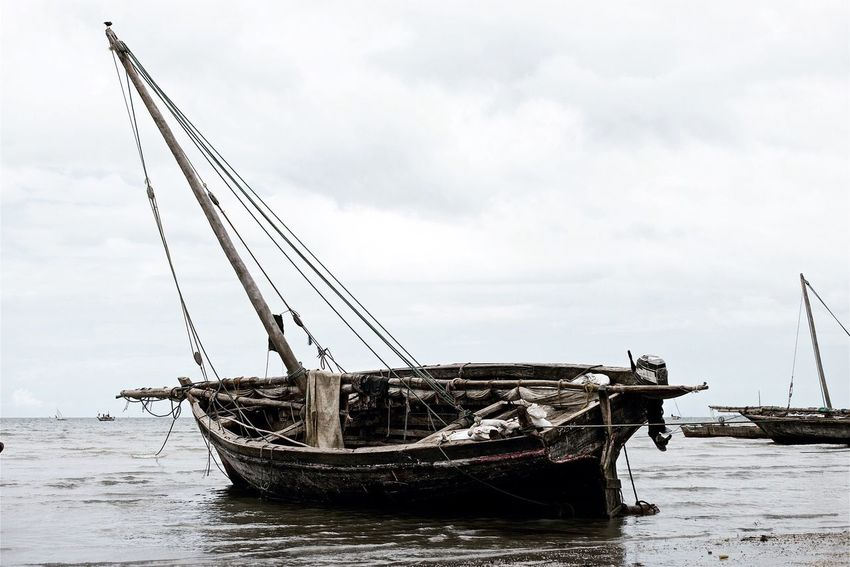 Bagamoyo beach, Tanzania. Was one of the most important trading ports along the East African coast. Facing the Indian Ocean, Tanzania. June 2014. Leicacamera Beach Boat
