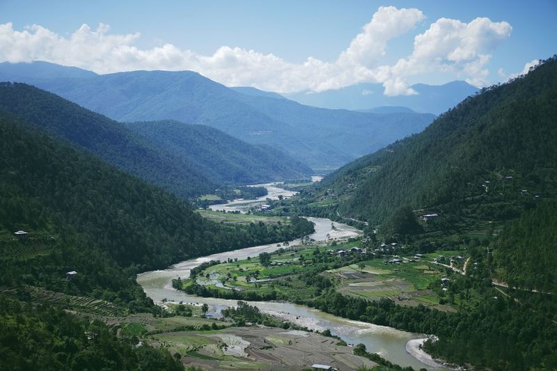 A river in Bhutan. Beauty In Nature Cloud - Sky Day Green Color Landscape Lush - Description Mountain Mountain Range Nature No People Outdoors Scenics Sky Travel Destinations