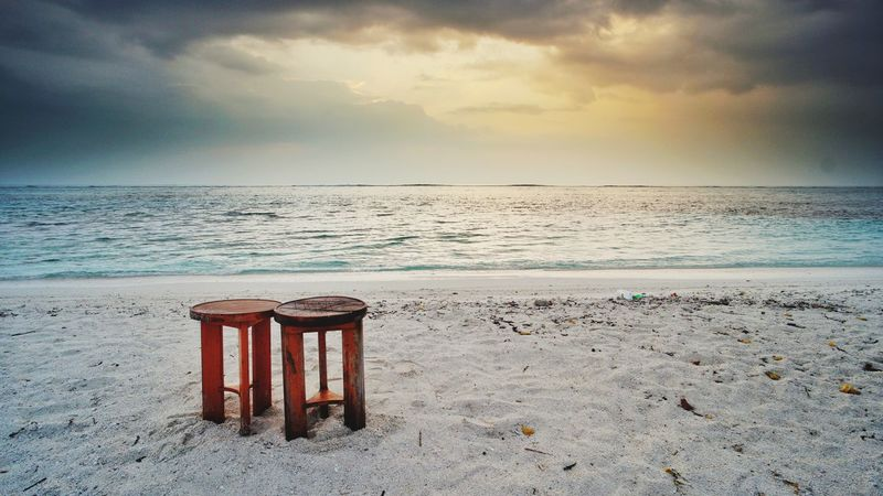 two wooden chairs isolated on sandy beach Wooden Wooden Chairs Two Sandy Beach Sandy Beach Maldives Bali Thailand Sunrise Seascape Beach Sea Sand Summer Horizon Over Water Vacations Sky Nature Tranquility Landscape Sunset Outdoors Water Scenics Relaxation Travel Destinations Tranquil Scene Beauty In Nature Sun