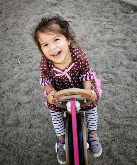 Portrait of smiling girl playing