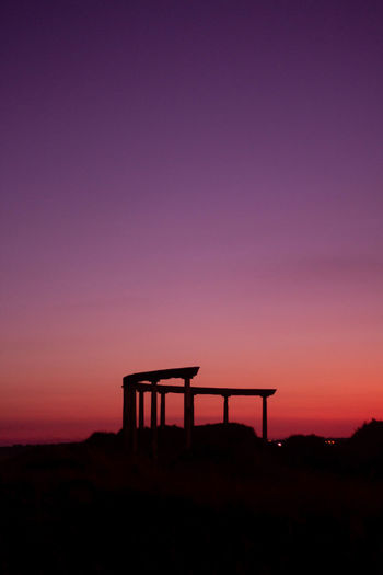 Silhouette Structure Against Sky During Sunset