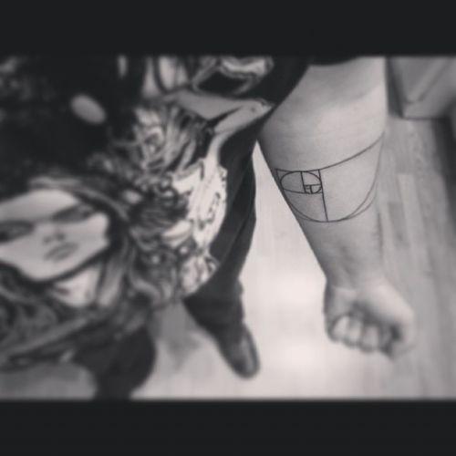 First tattoo: achievement unlocked Golden Spiral done by Beto at Rising Phoenix in Addison