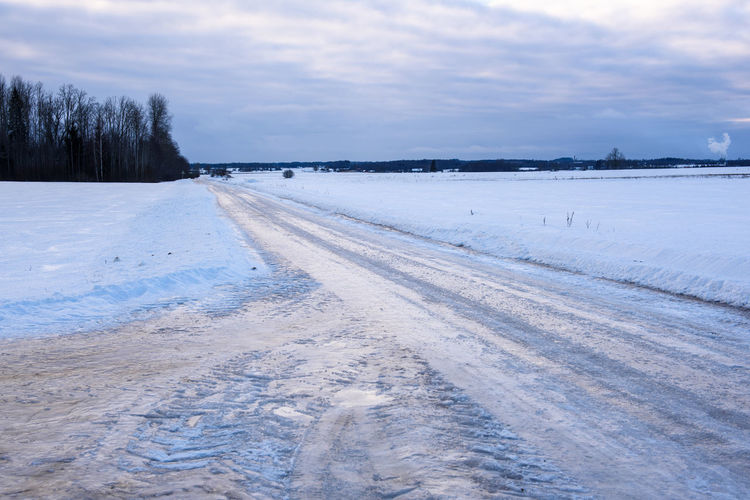 Very Icy, slippery countryside road. Snow Cold Temperature Winter Icy Road Ice On Road Nature Landscape Countryside Countryside Winter Scenics - Nature Plant Tranquil Scene Environment No People Tire Track Winter Wintertime Traffic Safety Driving Careful Driving