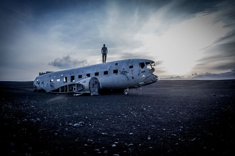 Iceland plane wreck Abandoned Airplane Transportation Real People Travel Exploration Adventure Sky Navy Sand Crash Damaged Cloud - Sky One Person Leisure Activity Accidents And Disasters Military Airplane Landscape Destruction Beach