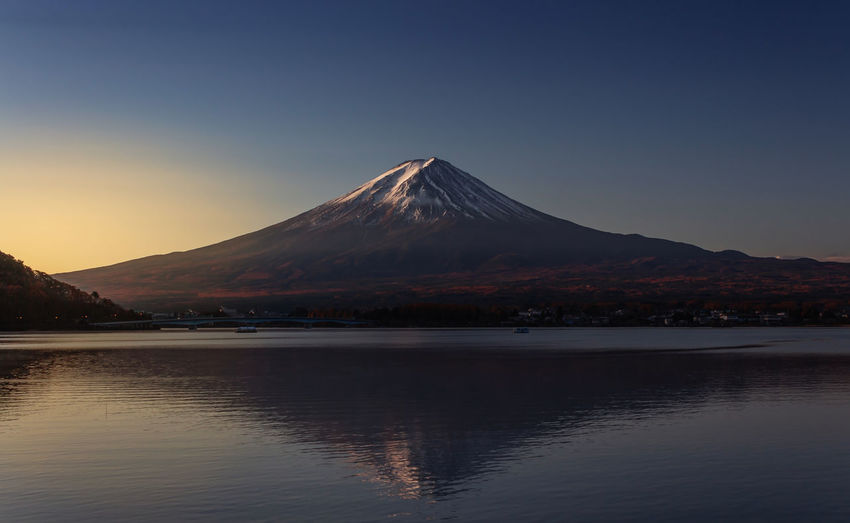 Fujisan Japan Nature Reflection Sunlight Travel Beauty In Nature Clear Sky Lake Landscape Mountain Mountain Peak No People Outdoors Scenics - Nature Snowcapped Mountain Sunrise Sunset Tourism Travel Destinations Volcano Waterfront