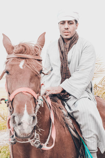 At upper egyot The Fashion Photographer - 2018 EyeEm Awards The Portraitist - 2018 EyeEm Awards The Traveler - 2018 EyeEm Awards Traditional Clothing Animal Wildlife Arabian Horse Domestic Domestic Animals Front View Herbivorous Horse Knight  Livestock Looking At Camera Mammal One Animal One Person Pets Portrait Real People Riding Riding Horses Three Quarter Length Vertebrate Working Animal