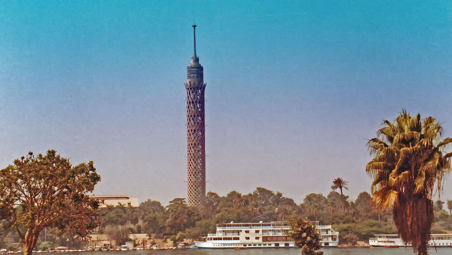 The Cairo Tower - Cairo, Egypt Architecture Nature City Sky Tree Blue Day Outdoors Tower Cairo Tower Egypt Monument Palm Tree Clear Sky No People Palm Trees ❤❤ Travel Destinations Built Structure A Taste Of Cairo Life In Cairo River Nile Cruiser