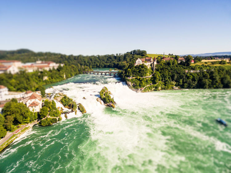 Rheinfall Rhine Rhine Falls Rhinefalls Architecture Beauty In Nature Clear Sky Day Landscape Motion Mountain Nature No People Outdoors River Scenics Schaffhausen Sky Sunlight Switzerland Travel Destinations Tree Water Waterfall Wave