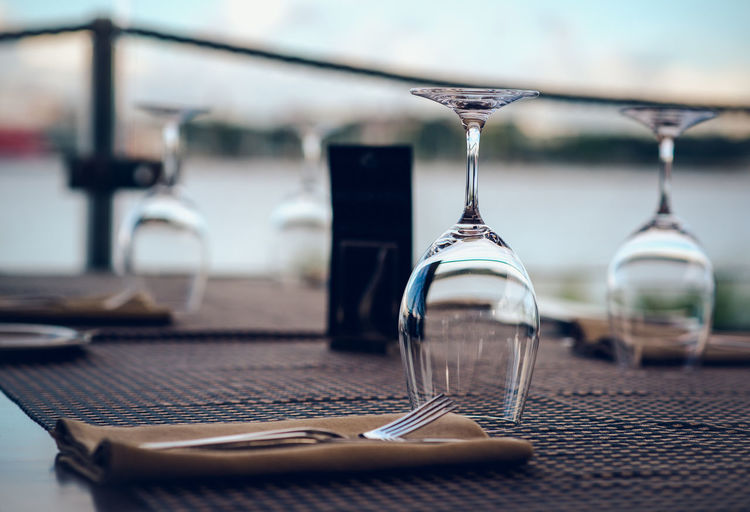 Empty wineglasses arranged on table