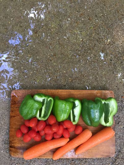Vegetables by the river Food Food And Drink Vegetable Healthy Eating Wellbeing Green Color Still Life Large Group Of Objects Cutting Board Directly Above Pepper Table Cucumber Indoors  Raw Food Red Close-up Freshness No People High Angle View