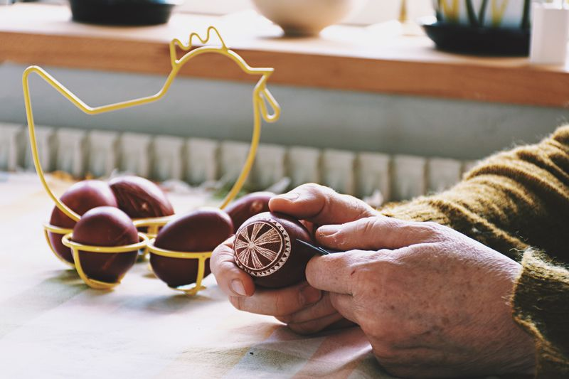 Cropped Image Of Hand Decorating Easter Egg