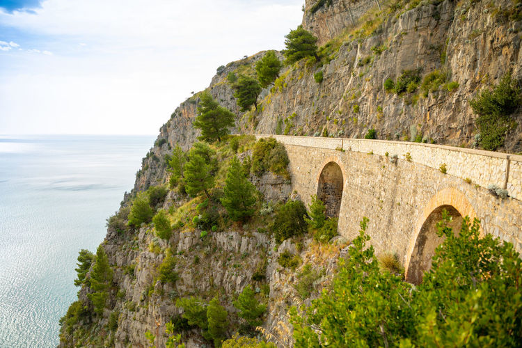 Italy Sicily Arch Sky Architecture Nature Travel Destinations Land Water Built Structure Scenics - Nature History Sea The Past Day Plant Travel No People Ancient Outdoors Beauty In Nature Arch Bridge