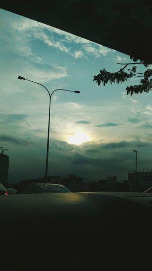 Street light against sky at sunset