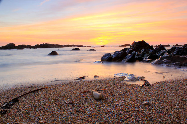 Beach Beauty In Nature Coastline Dramatic Sky Horizon Over Water Nature No People Outdoors Pebble Rock - Object Romantic Sky Sand Scenics Sea Sky Sunset Tranquility