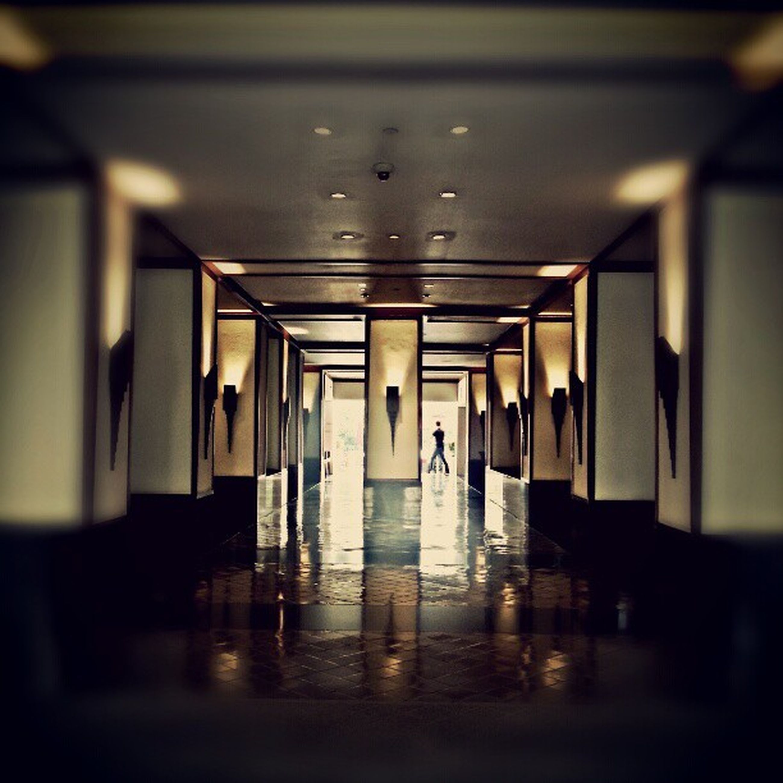 indoors, reflection, empty, in a row, illuminated, window, water, flooring, ceiling, selective focus, glass - material, absence, table, no people, built structure, architecture, interior, transparent, corridor, surface level