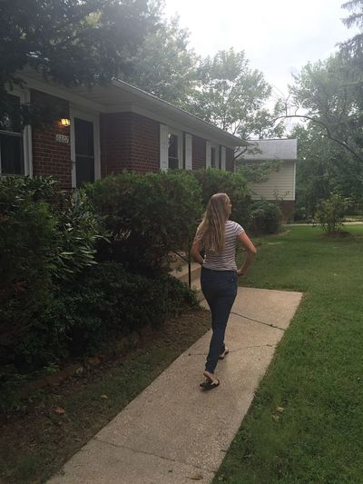 Enjoy The New Normal One Person Rear View Full Length One Woman Only Only Women Mid Adult Building Exterior Women Walking Real People People House Adult The Way Forward Adults Only Outdoors Road Day Architecture Young Adult McLean, Virginia