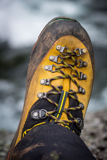 Low section of person wearing hiking boot